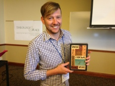Bradley's Dyche holds gift in recognition of his years of service as T&P President